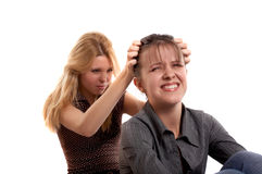 Aggression. Two girls in aggression on white Royalty Free Stock Images