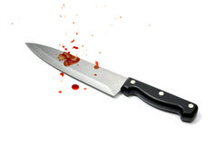 Aggression. Bloodstained knife on white background Royalty Free Stock Image