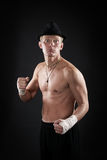 Aggression fighter. Man with nude torso like a boxing fighter Stock Photos