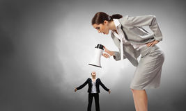 Aggression and humiliation in communication Stock Photo