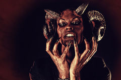 Aggression. Portrait of a devil with horns. Fantasy. Art project Royalty Free Stock Photography
