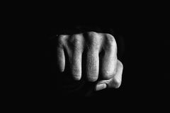 Aggression and punch. Photo of the fist of the person, which characterizes the impact, aggression and violence Royalty Free Stock Photos