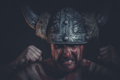 Aggression, Viking warrior with a horned helmet and war paint on Royalty Free Stock Photos
