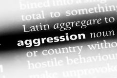 Aggression. Word in a dictionary.  concept royalty free stock photo
