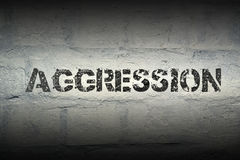 Aggression word gr. Aggression stencil print on the grunge white brick wall Royalty Free Stock Photos