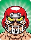 aggressiv fotbollsspelare Arkivfoto