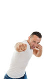 Aggressive adult man strikes blow with the clenched fist Royalty Free Stock Photo