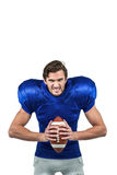 Aggressive american football player holding ball Stock Images