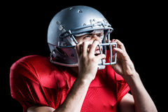 Aggressive American football player holding helmet Stock Photos