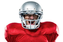Aggressive American football player in red jersey screaming. Portrait of aggressive American football player in red jersey screaming against white background Royalty Free Stock Image