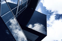Aggressive angles of a modern building made of glass with reflec Royalty Free Stock Photography