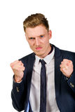 Aggressive angry young businessman raised hands and squeezed fists Royalty Free Stock Photo