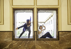 Aggressive assassin window. Scaring women in window, violence and fear Royalty Free Stock Images
