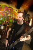 Aggressive bass player royalty free stock photos