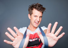 aggressive beautiful young man with braces on gre Stock Photo