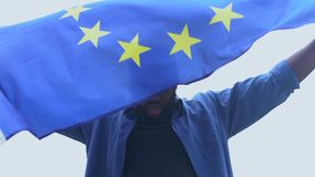 Aggressive black man raising European Union flag, human rights, racial equality. Stock footage stock video footage