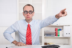 Aggressive boss says - go out of my office - dismissal. With red tie and a blue shirt Royalty Free Stock Photo
