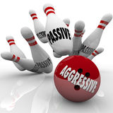 Aggressive Bowling Ball Striking Passive Pins Competitor. A red bowling ball with word Aggressive on it strikes pins marked Passive as a bold, formidable Royalty Free Stock Photos
