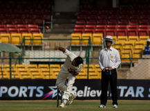 Aggressive bowling in cricket. Ashoke Dinda playing for Rest of India bowls aggressively during the ongoing Irani Cup game in Bengaluru. He is trying to bring Royalty Free Stock Photos
