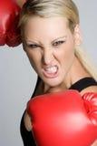 Aggressive Boxing Woman. Beautiful aggressive boxing fitness woman royalty free stock photos
