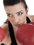 Aggressive boxing woman. Over white background Royalty Free Stock Photos