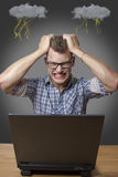 Aggressive boy sitting at the Computer Royalty Free Stock Photography