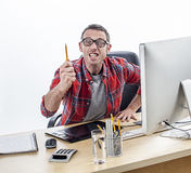 Aggressive business man threatening and pointing a pen expressing anger Stock Photos