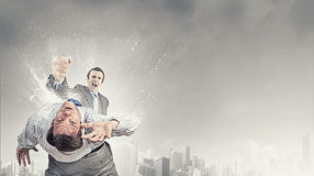 Aggressive business tactics Royalty Free Stock Images