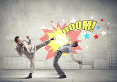 Aggressive business tactics Stock Photography