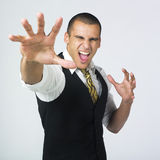 Aggressive businessman. A studio portrait of a businessman  showing two hands with an aggressive or stressed expression on his face Royalty Free Stock Images