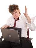 Aggressive businessman with laptop in crisis. Stock Images