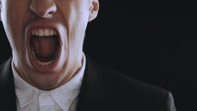 Aggressive businessman in a suit is screaming and showing anger on a black background. Angry boss. The danger of. Angry businessman screaming at white background stock video