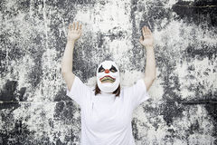 Aggressive Clown. Crazy clown mask halloween costume and fear stock image