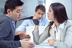 Aggressive colleague in office Stock Images
