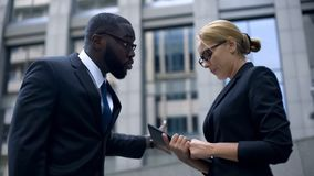 Aggressive companys head scolding female employee for bad result of job, report. Stock photo stock photography