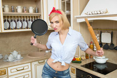 Aggressive cook in a pan, on the background of the Royalty Free Stock Photography