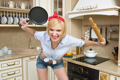 Aggressive cook in a pan, on the background of the Stock Images
