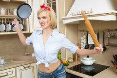 Aggressive cook in a pan, on the background of the Royalty Free Stock Photo