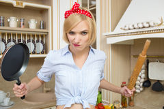 Aggressive cook in a pan, on the background of the Royalty Free Stock Photos