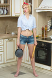 Aggressive cook in a pan, on the background of the Royalty Free Stock Images