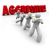Aggressive 3d Word Pulled by Determined Team Workers Royalty Free Stock Photo