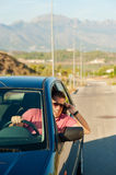 Aggressive driver. Aggressive guy yelling on the phone whiledriving Stock Image