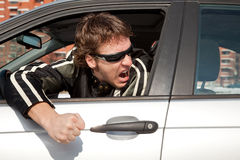 Aggressive driver. Concept, young man driving aggressively Stock Photography