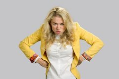 Aggressive frowning young business woman. Stock Image
