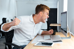 Free Aggressive Furious Businessman Shouting And Working With Computer In Office Royalty Free Stock Image - 74637346
