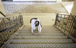 Aggressive girl climbing stairs Stock Photos