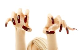 Aggressive girl hands with long acrylic nails. Over white stock images