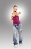 Aggressive girl makes a punch. On a white background royalty free stock images