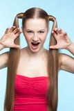 Aggressive girl in red dress Royalty Free Stock Photos