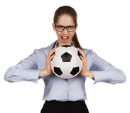 Aggressive girl with a soccer Ball Stock Image